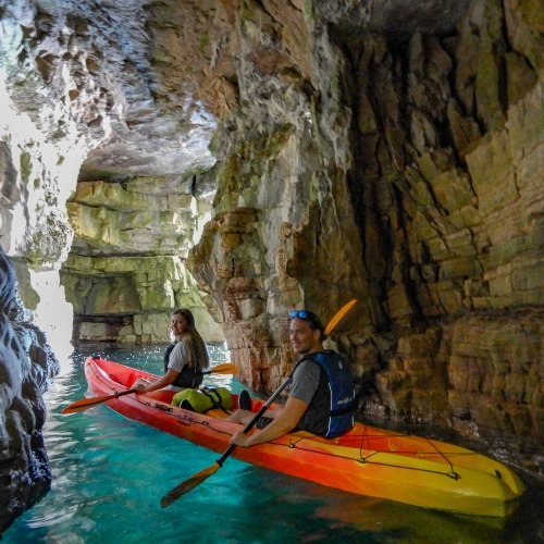 kayak in a tight cave in Pula